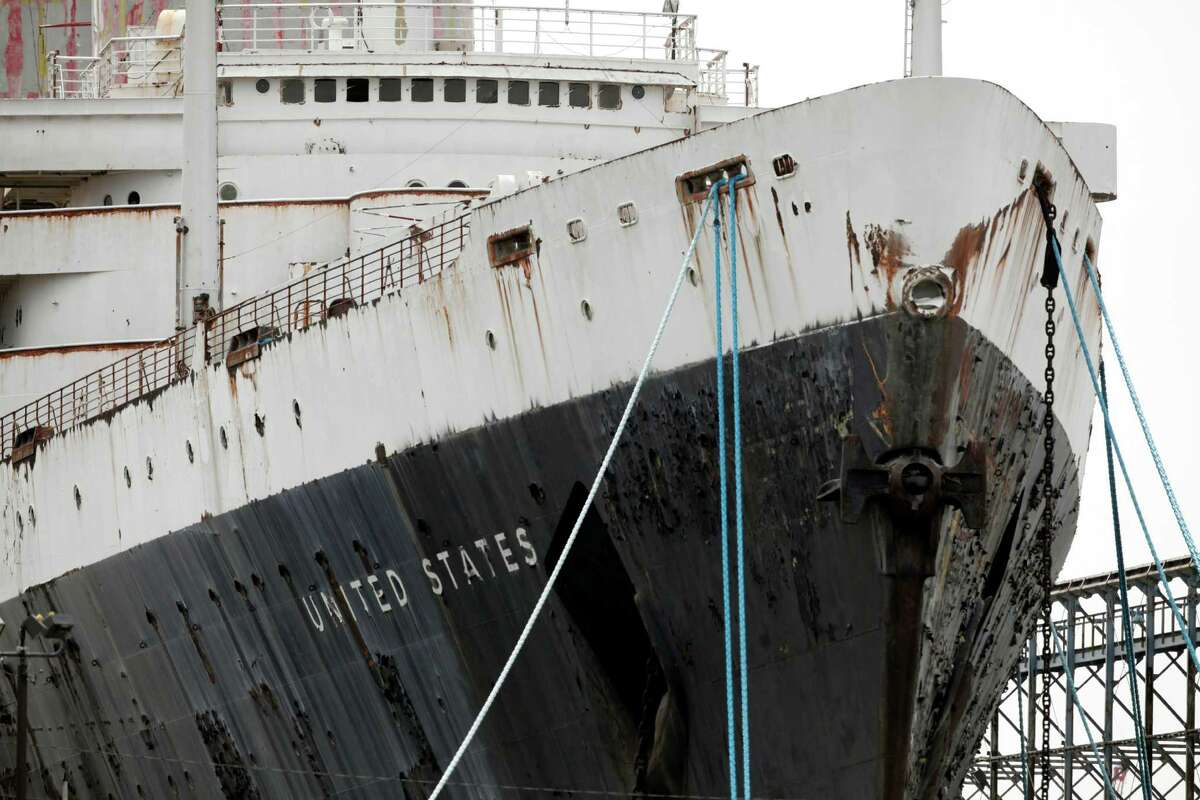 In this July 9, 2012 photo the SS United States is seen moored on the Delaware River, in Philadelphia. Caretakers for the legendary ocean liner are renewing and expanding their distress call for the beleaguered piece of American maritime history. (AP Photo/Brynn Anderson)