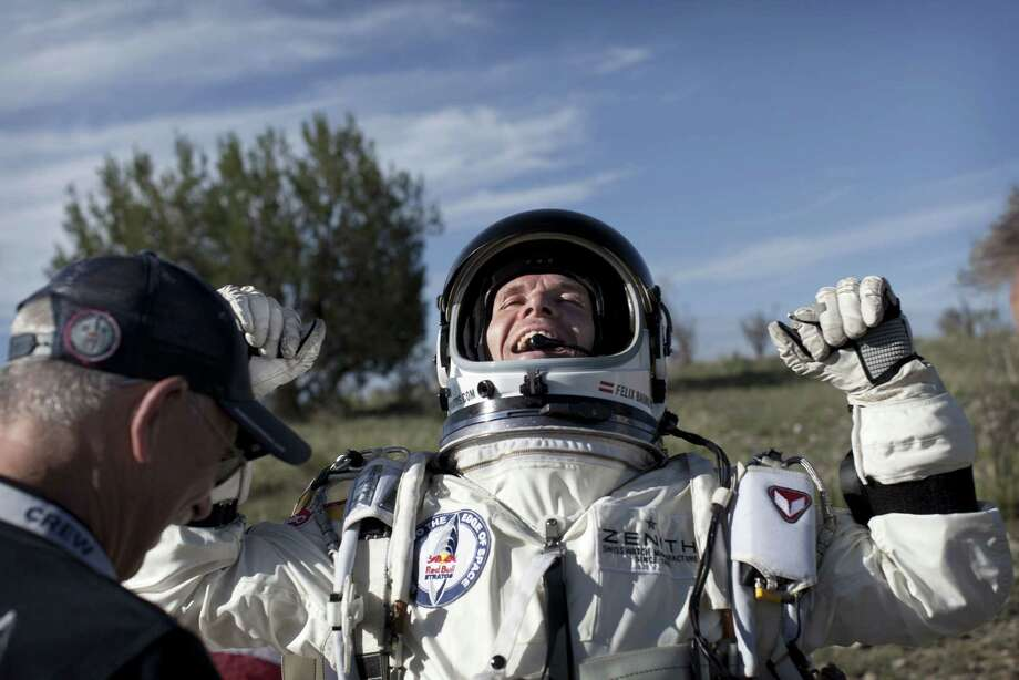 Felix Baumgartner of Austria cheers in New Mexico after his 96,640-foot leap from a balloon capsule. Photo: Handout / 2012 Red Bull