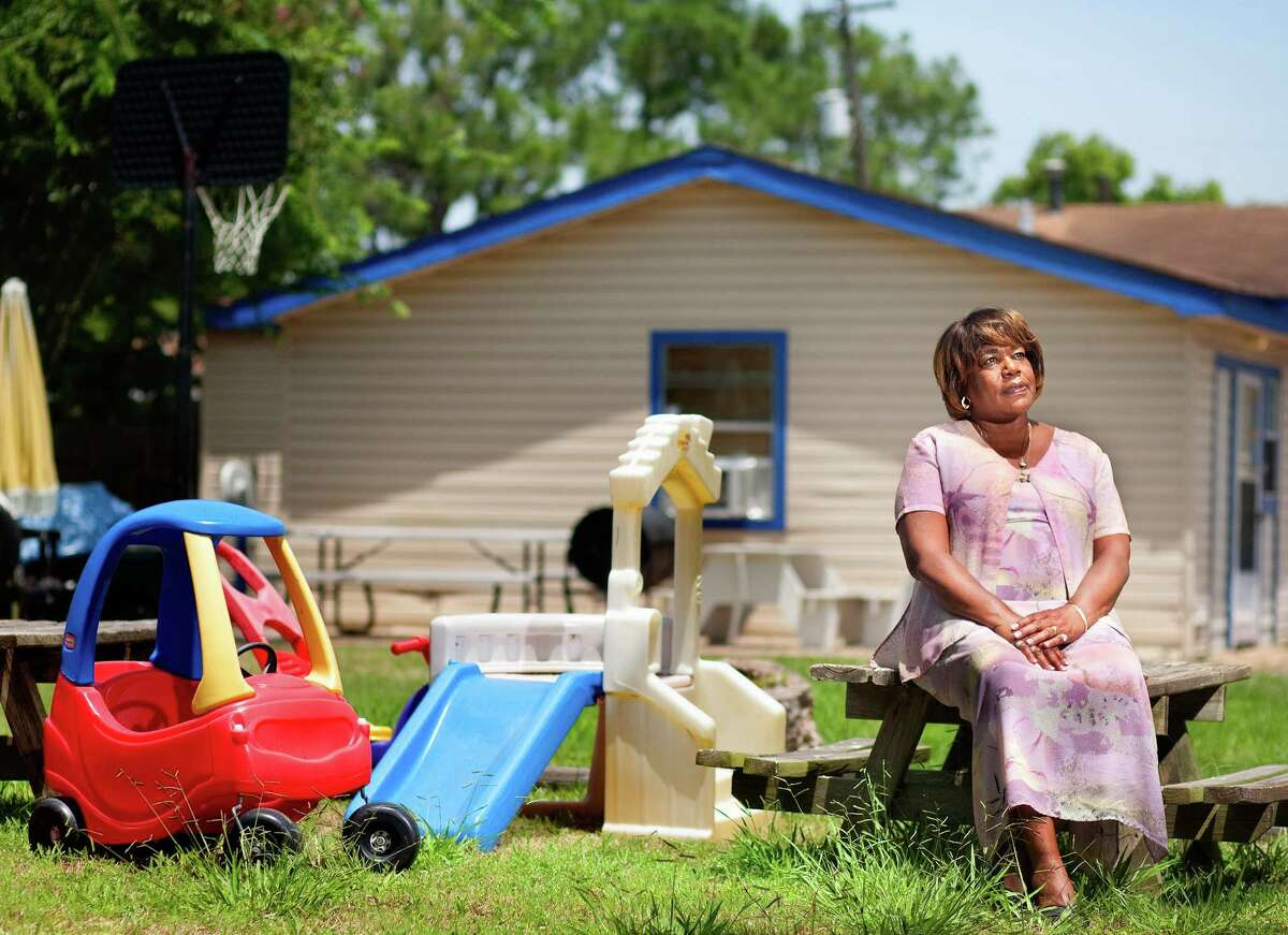 Mary Brooks - in the backyard of her former Texas City day care center - is one of 48,380 Texas City and La Marque residents suing BP for health problems.