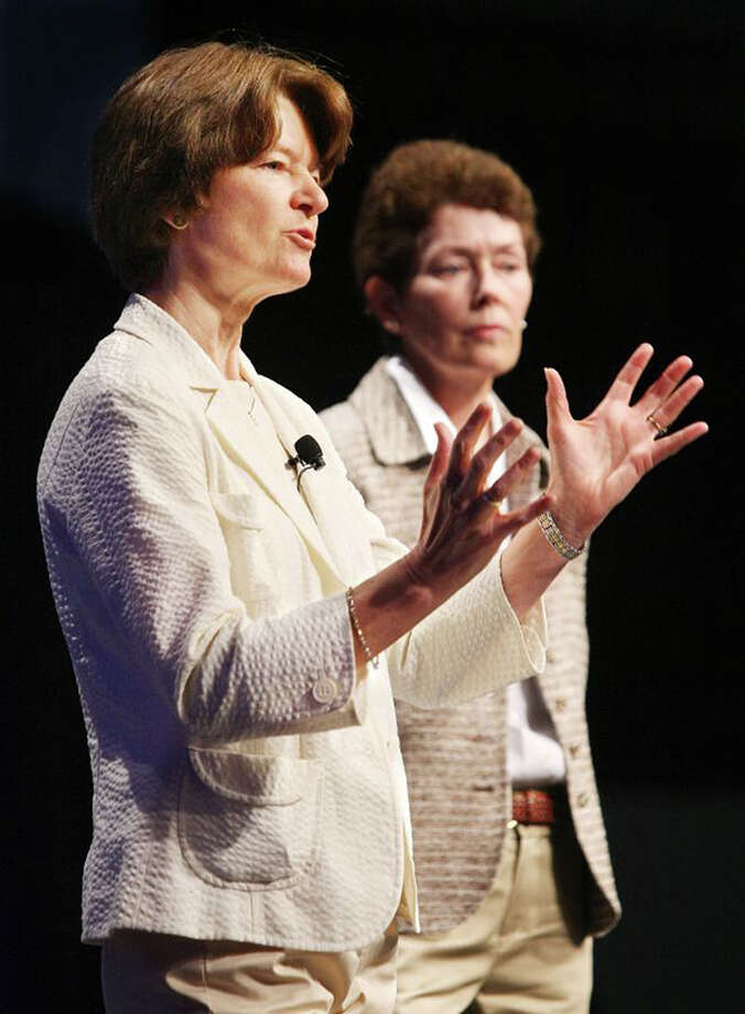 In this June 29, 2008 photo made available by the American Library Association, Sally Ride, foreground, and Tam O-Shaughnessy discuss the role of women in science and how the earth's climate is changing during an ALA conference in Anaheim, Calif. The pioneering astronaut, who relished privacy as much as she did adventure, chose an appropriately discreet manner of coming out. At the end of an obituary that she co-wrote with her partner, Tam O'Shaughnessy, they disclosed to the world their relationship of 27 years. As details trickled out after Ride's death on Monday, July 23, 2012, it became clear that a circle of family, friends and co-workers had long known of the same-sex relationship and embraced it. For many millions of others, who admired Ride as the first American woman in space, it was a revelation - and it sparked a spirited discussion about privacy vs. public candor in regard to sexual orientation. (AP Photo/American Library Association, Curtis Compton) Photo: Curtis Compton