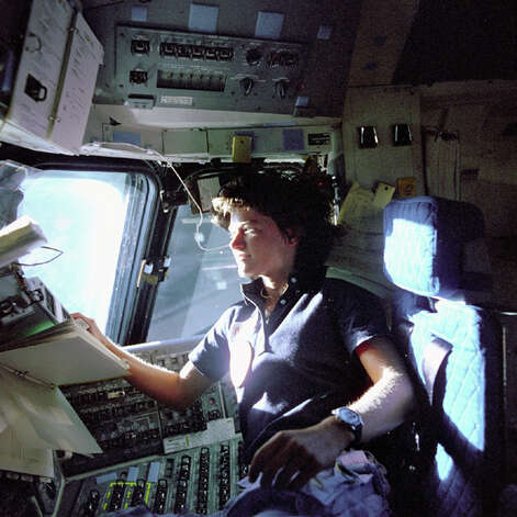FILE - In this June 1983 photo released by NASA, astronaut Sally Ride, a specialist on shuttle mission STS-7, monitors control panels from the pilot's chair on the space shuttle Challenger flight deck. The pioneering astronaut, who relished privacy as much as she did adventure, chose an appropriately discreet manner of coming out. At the end of an obituary that she co-wrote with her partner, Tam O'Shaughnessy, they disclosed to the world their relationship of 27 years. As details trickled out after Ride's death on Monday, July 23, 2012, it became clear that a circle of family, friends and co-workers had long known of the same-sex relationship and embraced it. For many millions of others, who admired Ride as the first American woman in space, it was a revelation - and it sparked a spirited discussion about privacy vs. public candor in regard to sexual orientation. (AP Photo/NASA, File)