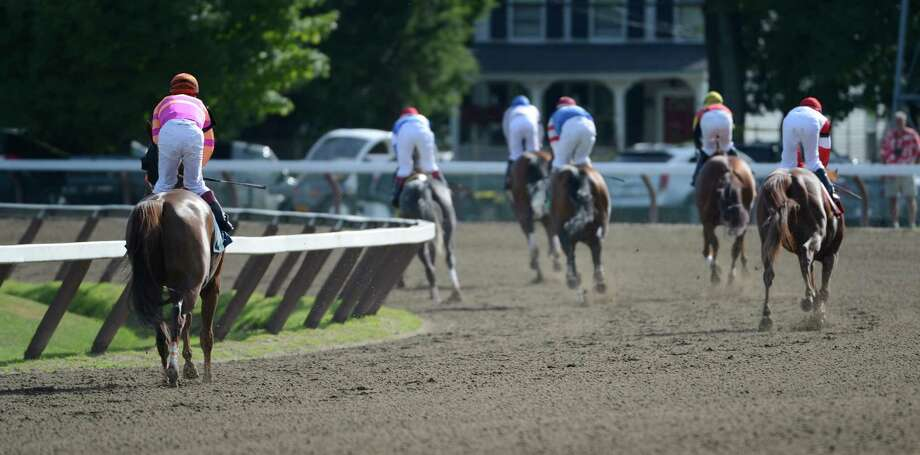 2011 Belmont Stakes winner Ruler on Ice, left with jockey Javier Castellano in the saddle had a very disappointing finish in the 8th race where he finished last in a field of seven at the Saratoga Race Course in Saratoga Springs, N.Y. July 25, 2012.     (Skip Dickstein/Times Union) Photo: Skip Dickstein