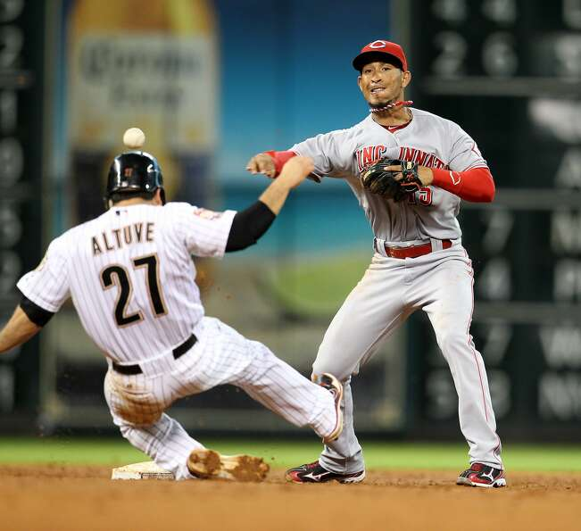Reds shortstop Wilson Valdez throws out Astros center fielder Justin Maxwell after forcing out Astro