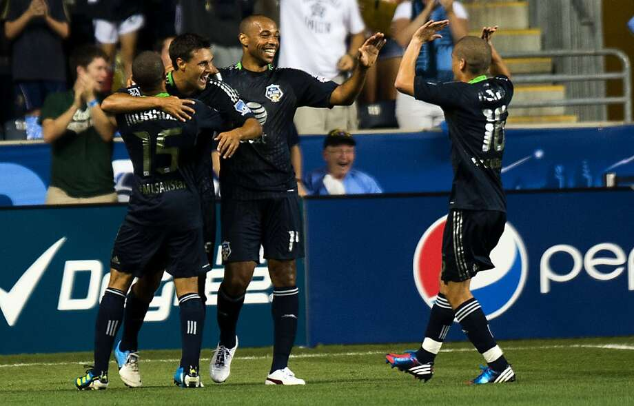 MLS All-Star Chris Wondolowski (2L) celebrates his 1st half goal with teammates Justin Morrow (L), Thierrry Henry (2R) and Osvaldo Alonso (R) during the 2012 AT&T All-Star match against Chelsea FC at PPL Park in Philadelphia, Pennsylvania, July 25, 2012.  Major League Soccer hosts its midseason showcase match between the League's top players and the best of the world, this year taking on Chelsea FC of the English Premier League.                   AFP PHOTO/Jim WATSONJIM WATSON/AFP/GettyImages Photo: Jim Watson, AFP/Getty Images