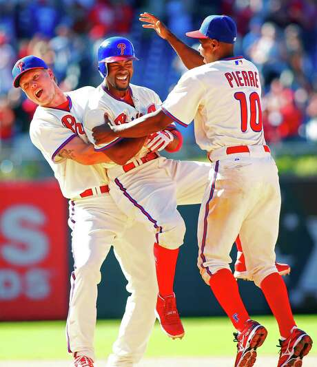 The Phillies celebrate another walk-off win, this one courtesy of an RBI single by Jimmy Rollins, center. Photo: Rich Schultz / 2012 Getty Images
