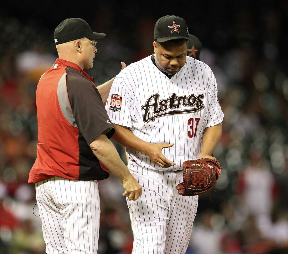 For the second straight night, Brad Mills has to pull Francisco Cordero after a blown save in the ninth. Photo: Karen Warren / © 2012  Houston Chronicle