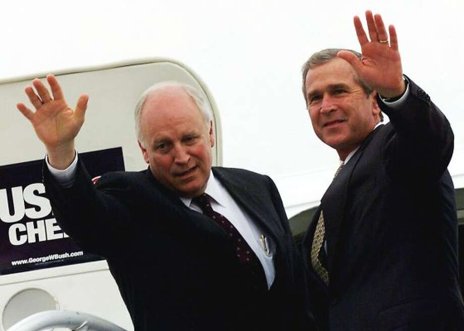"Republican running mates George W. Bush and Dick Cheney, at a 2000 rally where an open mike caught Bush whispering to Cheney:  ""There's Adam Clymer, major league a*****e from The New York Times."" (AFP/Getty Images)"