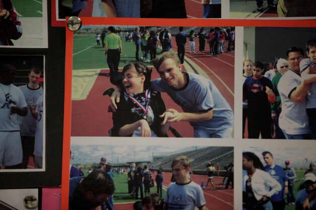 Photos of Kassie Sanchez and Adrian Pressey at a Special Olympics track and field event hang in a display cabinet in a hallway at Clark High School on Thursday, May 10, 2012. Photo: Lisa Krantz, San Antonio Express-News / San Antonio Express-News
