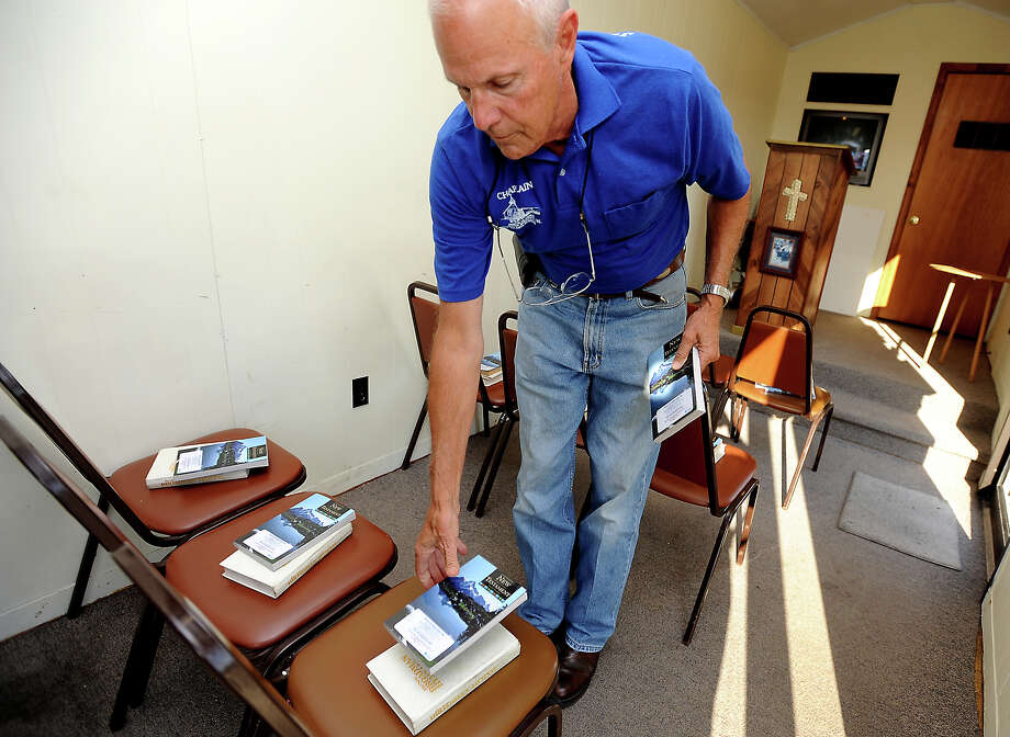 Chaplain Mike Sculley lays out reading material on chairs for church services in a box trailer for truckers at the Petro truck stop in Beaumont, Tuesday, July 24, 2012. Tammy McKinley/The Enterprise Photo: TAMMY MCKINLEY