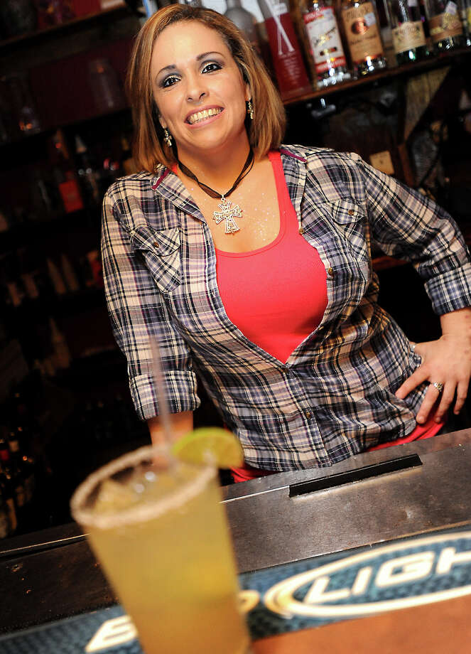 Penny Brooks of Dixie Dance Hall in Beaumont is the Cat5 Bartender of the Week. Tammy McKinley/The Enterprise Photo: TAMMY MCKINLEY