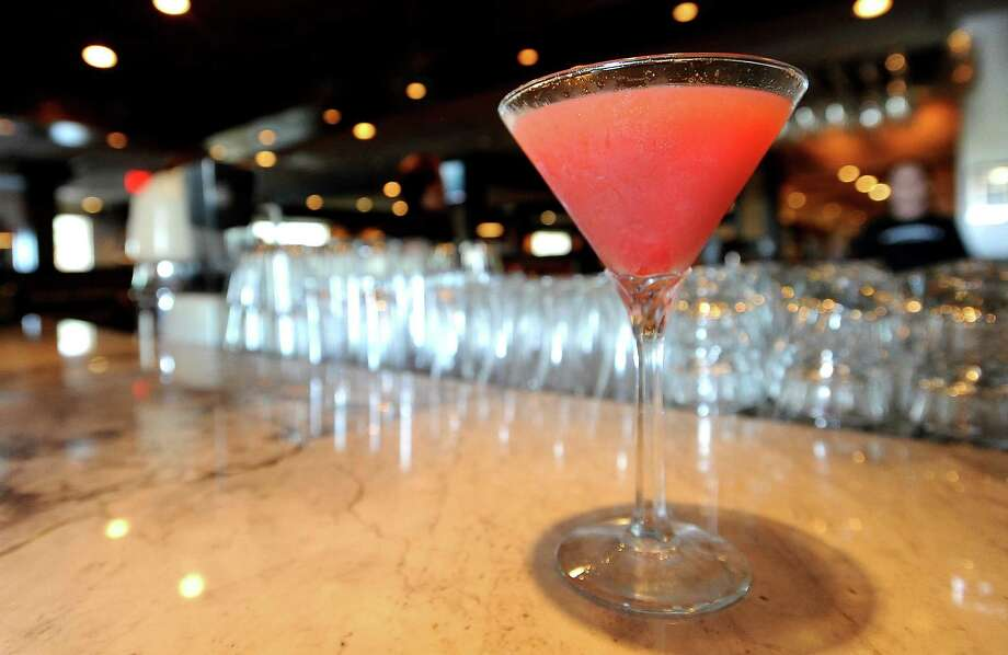 Pomegranate Martini is a popular drink at Carrabba's in Beaumont. Tammy McKinley/The Enterprise Photo: TAMMY MCKINLEY