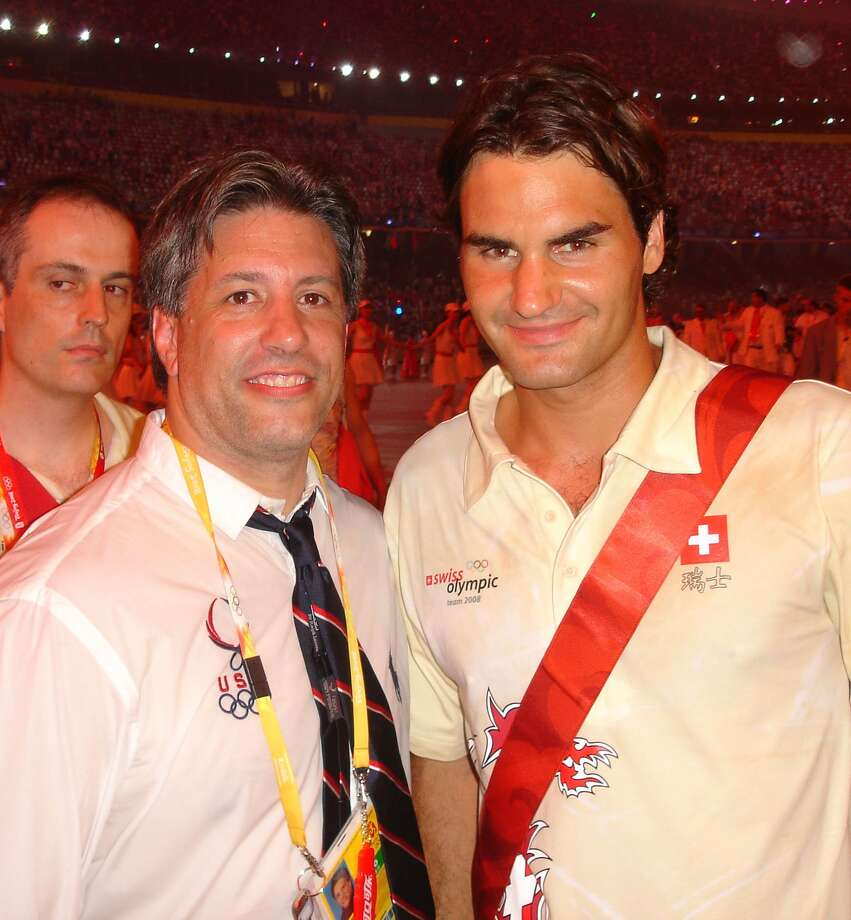 Jason Morris with Roger Federer at the 2008 Olympic opening ceremonies.