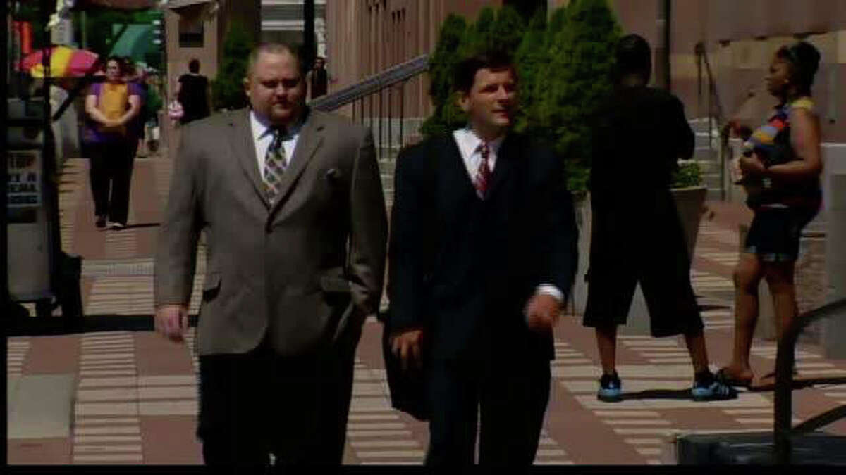 Former finance director for Christopher Donovan's Congressional campaign, Robert Braddock Jr., left and his attorney, Frank J. Riccio II, walk into federal court in New Haven, Conn. on Thursday, July 12, 2012. Braddock was indicted by a federal grand jury on July 11 for his alleged role in a conspiracy to conceal the identities of campaign donors. Braddock entered a not guilty plea during his July 12 court appearence.
