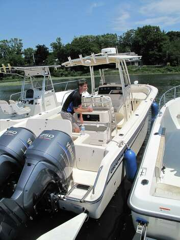 Jim Batson packs up his boat, Sea Heaven, after a morning on Long Island Sound with his family, Friday, July 6, 2012. Darien, Conn. Photo: Thomas Michael