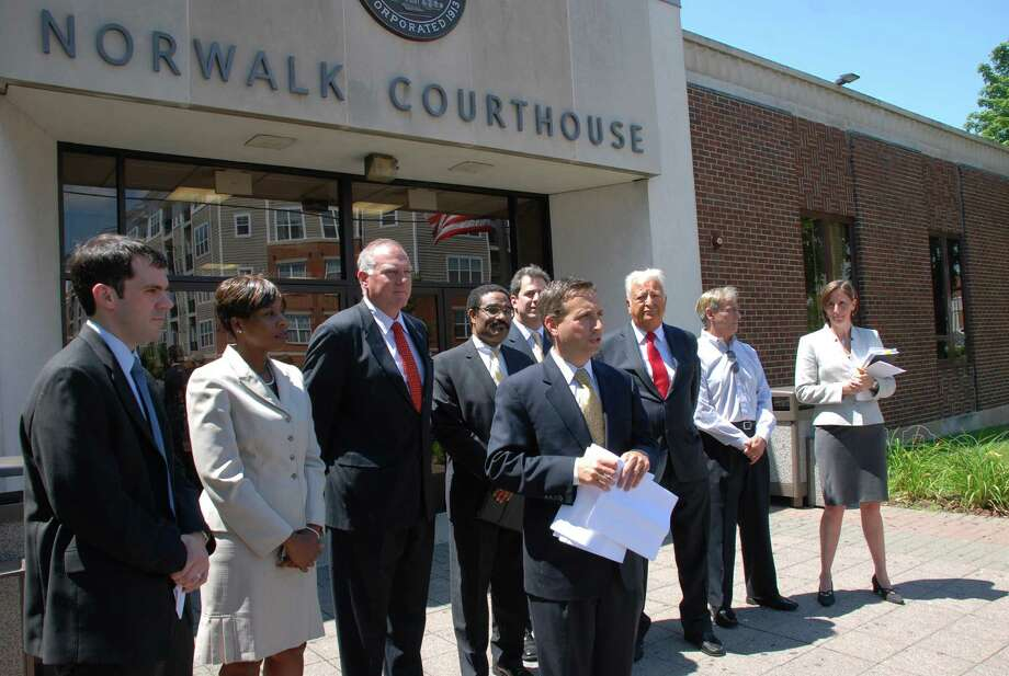 State Sen. Bob Duff and Attorney General George Jepsen lead a press conference Tuesday at the Norwalk Courthouse to raise awareness about mortgage assistance programs. Photo: Contributed Photo