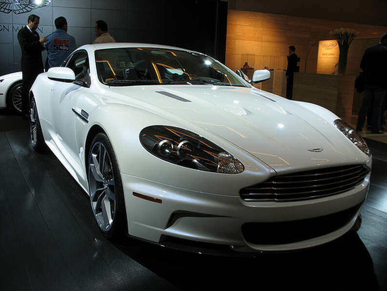 Aston Martin DBS: 11 city, 17 highway, 13 combined. To drive 25 miles, it would cost $6.63.