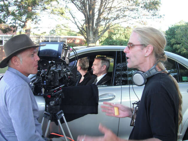 "Director of Photography Axel Fischer (left) and director Michael Patrick Kelly confer before shooting a scene in ""Isn't It Delicious?"" which was shot on location in Connecticut last year and will be getting its first public screening at the Fairfield Theatre Company on Aug. 6. Photo: Contributed Photo"