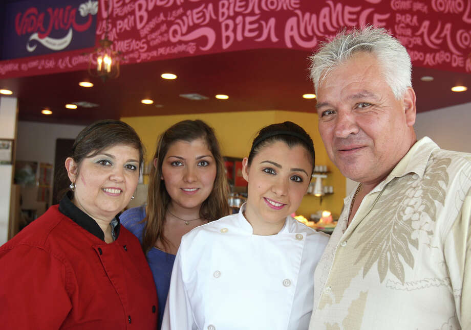(From left) Maria Elena, Maria Elena, Mayela and Jose Ramos pose for a portrait Monday July 23, 2012 in their restaurant Vida Mia. The Ramos family left everything in Monterrey to open a business here, in large part, to escape the drug violence over there. Photo: Julysa Sosa / SAN ANTONIO EXPRESS-NEWS