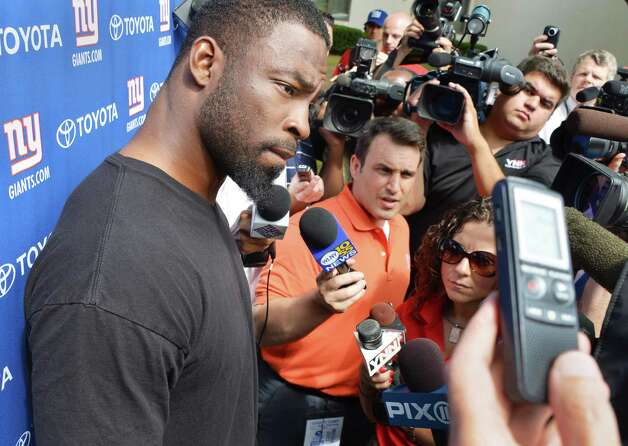 New York Giants defensive captain Justin Tuck talks with reporters at UAlbany during training camp Thursday July 26, 2012.   (John Carl D'Annibale / Times Union) Photo: John Carl D'Annibale