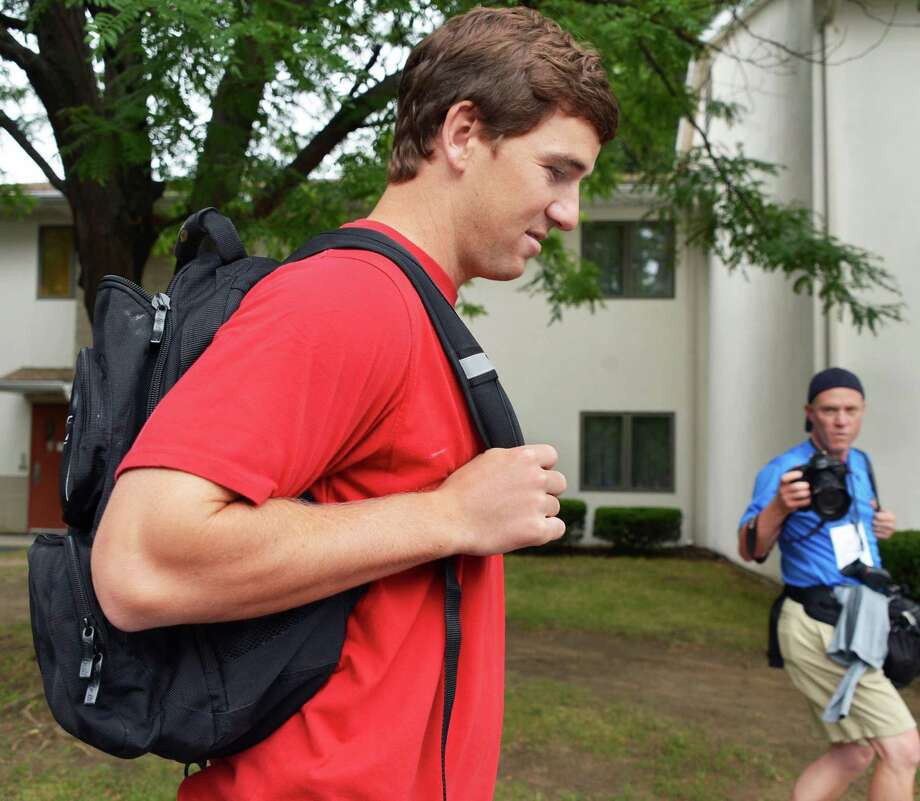 New York Giants' QB Eli Manning outside his UAlbany dorm at this season's training camp Thursday July 26, 2012.   (John Carl D'Annibale / Times Union) Photo: John Carl D'Annibale
