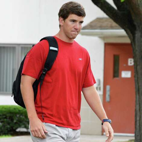 New York Giants' QB Eli Manning arrives at UAlbany for this season's training camp Thursday July 26, 2012.   (John Carl D'Annibale / Times Union) Photo: John Carl D'Annibale