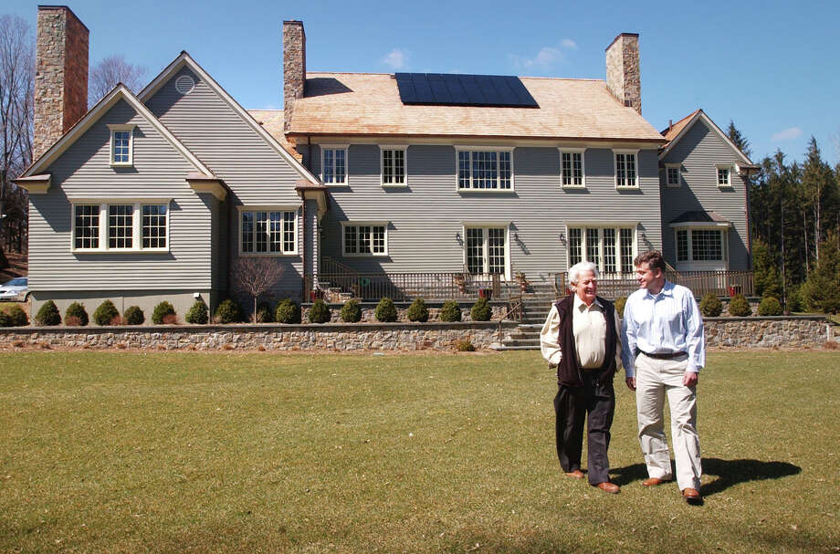 Irwin Stillman and his son Robert in April 2007 stand in front of a home they built on Panhandle Lane with solar panels on the roof and a geothermal heating system. Westport and Fairfield are among four towns chosen to participate in Solarize Connecticut, a state program that reduces residential solar panel installations through group purchasing. Photo: File Photo, ST