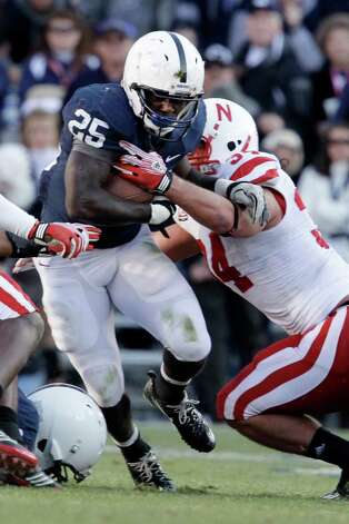 Penn State running back Silas Redd (25) is tackled by Nebraska's Cameron Meredith during the first quarter of an NCAA college football game in State College, Pa., Saturday, Nov. 12, 2011. (AP Photo/Gene J. Puskar) Photo: Gene J. Puskar, Associated Press / AP