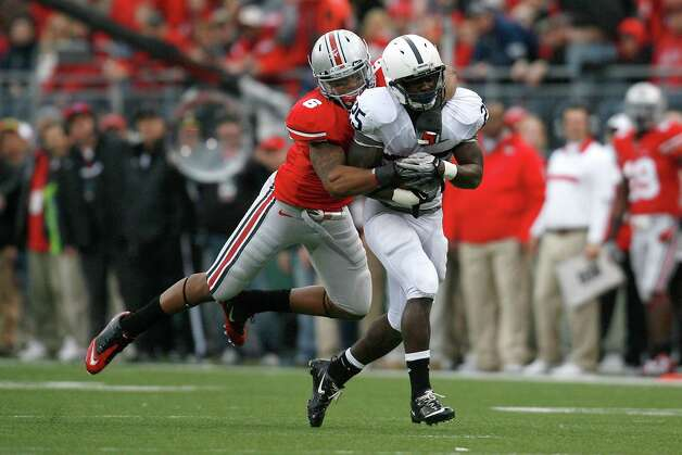 COLUMBUS, OH - NOVEMBER 19:  Etienne Sabino #6 of the Ohio State Buckeyes drags down Silas Redd # 25 of the Penn State Nittany Lions during the second quarter on November 19, 2011 at Ohio Stadium in Columbus, Ohio. (Photo by Kirk Irwin/Getty Images) Photo: Kirk Irwin, Getty / 2011 Getty Images