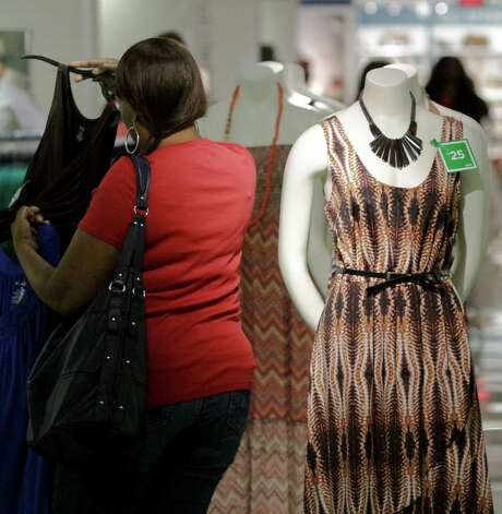 In this June 8, 2012 photo, a dress display with a green tag item price for the month of June is displayed at a J.C. Penney store in New York. Six months after J.C. Penney got rid of the hundreds of sales it offers each year in favor of a three-tier pricing approach, the mid-priced department store chain is revamping its pricing strategy again. (AP Photo/Bebeto Matthews) Photo: Bebeto Matthews, STF / AP