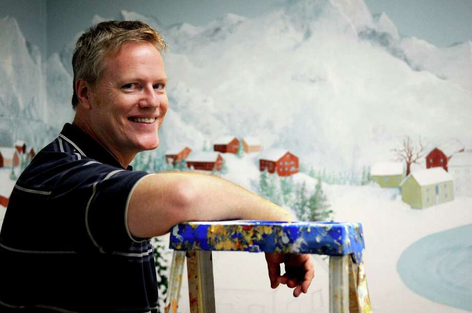 Joe Belisle takes a break from painting murals to pose for a photo at Stamford Twin Rinks on Thursday, July 26, 2012. Photo: Lindsay Niegelberg / Stamford Advocate