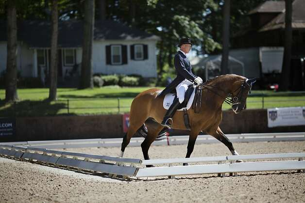 FILE -- Jan Eberling, a horse trainer, rides Rafalca, a dressage horse owned by himself and Ann Romney, during a competition at the United States Equestrian Federation National Grand Prix Dressage Championship and Selection Trial for the Olympic Games at Hamilton Farm in Gladstone, N.J. June 16, 2012. The 15-year-old mare will make her Olympic debut during the dressage event in the 2012 London Olympics. (Victor J. Blue/The New York Times) Photo: Victor J Blue, New York Times