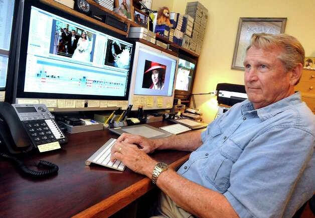 Bill Cafarelli works editing wedding video in his Newtown business Thursday, July 26, 2012. Photo: Michael Duffy / The News-Times
