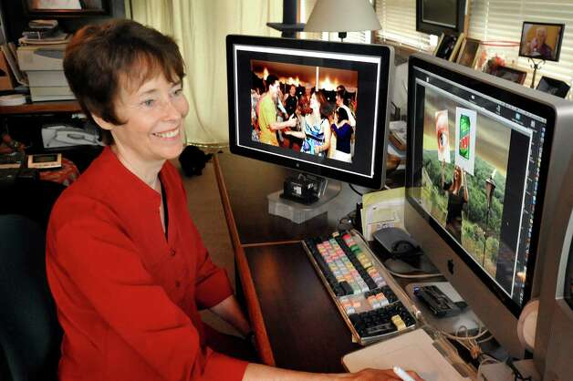 Marleen Cafarelli works editing wedding photos in her Newtown business Thursday, July 26, 2012. Photo: Michael Duffy / The News-Times