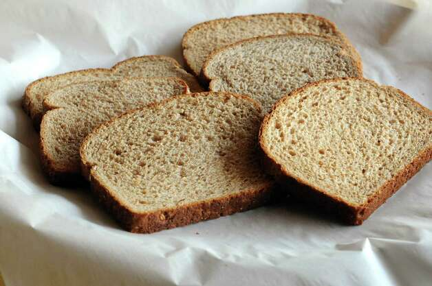 A view of the six different brands of whole wheat breads used in a blind taste-test on Thursday, July 19, 2012 in Albany, NY.  (Paul Buckowski / Times Union) Photo: Paul Buckowski, Albany Times Union / 00018499A