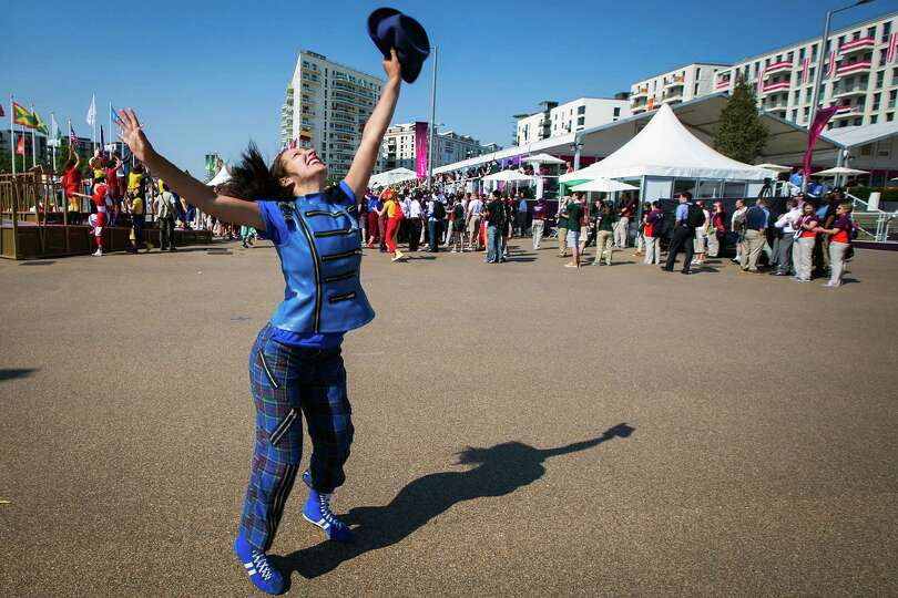 Performers dance during a welcome ceremony for Team USA at the Olympic Village on the eve of the Ope