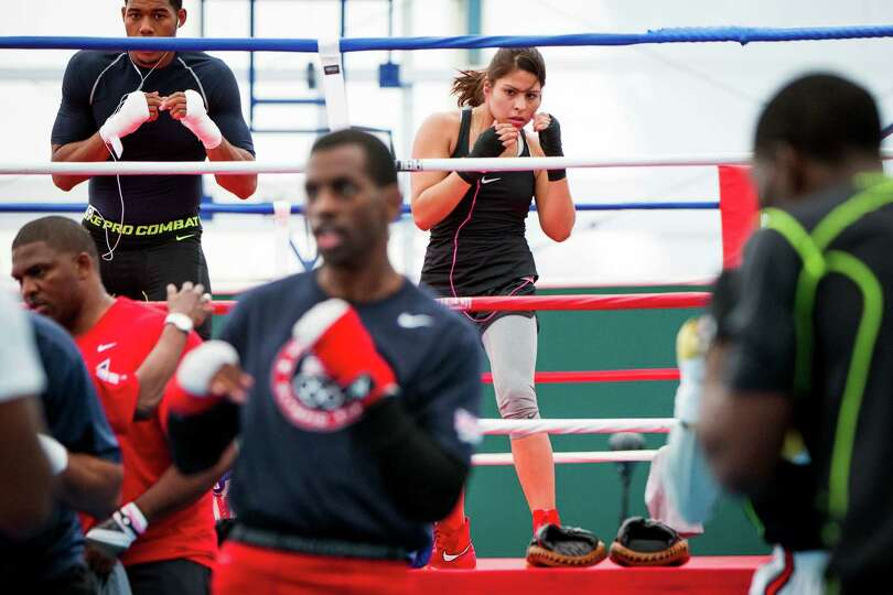 Boxer Marlen Esparza, of Houston, trains with Team USA on the eve of the Opening Ceremonies for the