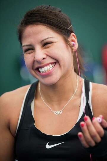 Boxer Marlen Esparza, of Houston, laughs with a teammate as she trains with Team USA on the eve of t