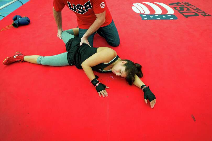 Boxer Marlen Esparza, of Houston, stretches before a Team USA training session on the eve of the Ope