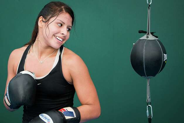 Boxer Marlen Esparza, of Houston, trains with Team USA on the eve of the Opening Ceremonies for the 2012 London Olympics on Thursday, July 26, 2012. Photo: Smiley N. Pool, Houston Chronicle / © 2012  Houston Chronicle