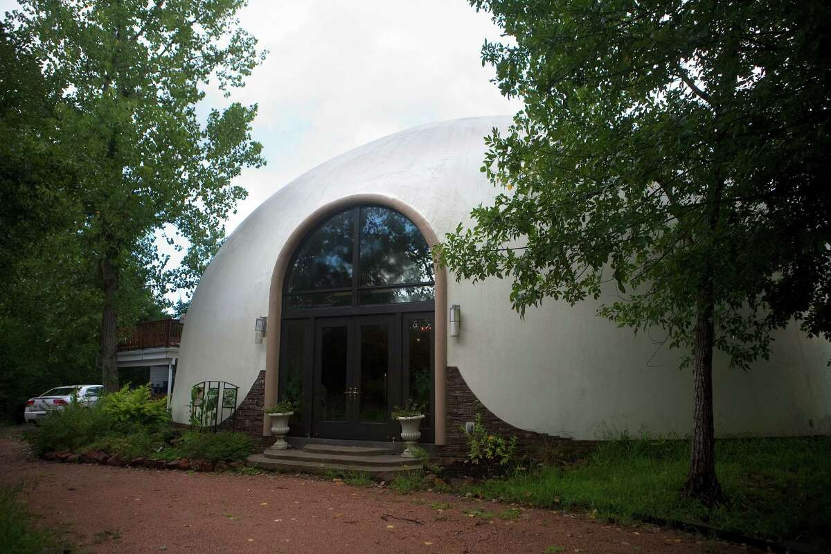 Glen Douglas' pipe organ, above, is comprised of 7,000 different pipes and three consoles with keyboards. Douglas essentially lives inside the organ. Davis built Aeolian Manor, left, a monolithic dome, to house the organ. The shape was chosen for its acoustics.