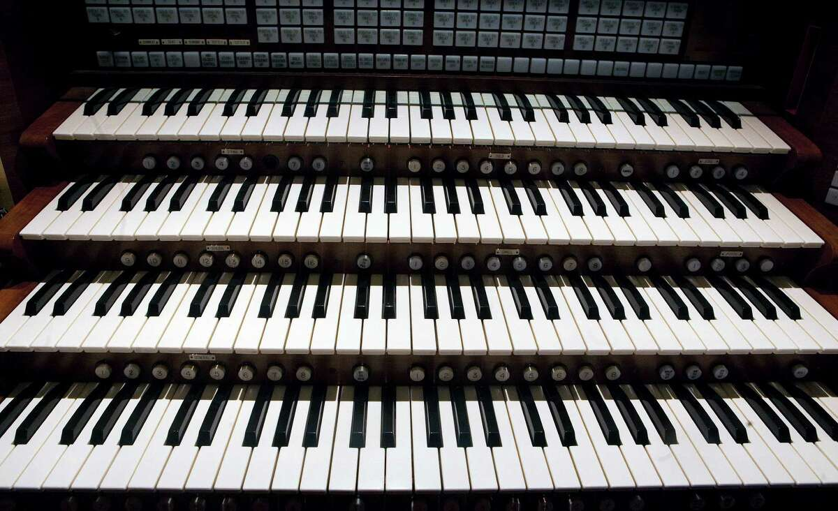 A set of keys on an organ owned by Glen Douglas is seen Thursday, July 19, 2012, in Houston. The organ is comprised of 7,000 different pipes and three consoles with keyboards. Douglas essentially lives inside the organ. (Cody Duty / Houston Chronicle)