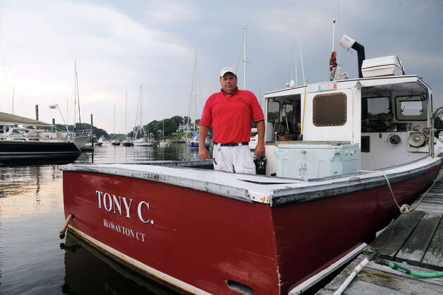 Lobsterman Tony Carlo aboard his boat in Rowayton Harbor in Rowayton, Conn., July 18, 2012.  The state is researching the continuing decline of the state's lobster population after yet another devastating year of diminished catches for the dwindling ranks of commercial lobstermen. Carlo blames pesticides used in landscaping and pest control treatments for the declining lobster population. Photo: Keelin Daly / Stamford Advocate