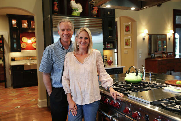 Linda and Kurt Myers stand by a Wolf stove in their kitchen at their ranch home near Fair Oaks Ranch, Wednesday, July 18, 2012. Photo: Jerry Lara, San Antonio Express-News / © 2012 San Antonio Express-News
