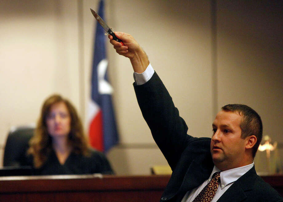 Defense Attorney Robert Gebbia uses the knife used in the stabbing of Antwan Wolford to emphasize his point during closing arguments in Tiffany James' murder trial for the death of Wolford in the Bexar County 399th District Court on Thursday, July 26, 2012. Looking on is Judge Juanita Vasquez-Gardner. Photo: Lisa Krantz, San Antonio Express-News / San Antonio Express-News