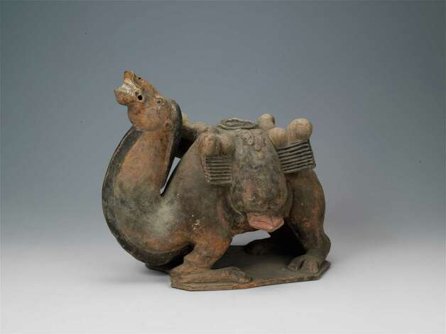 Sitting Camel Northern Qi dynasty (550?577 CE), tomb dated 570 CE Painted earthenware, 24.7 x 29.7 cm  Unearthed 1979, tomb of Lou Rui (d. 570 CE), Wangguo Village, Taiyuan, Shanxi Province Shanxi Museum, Taiyuan (Courtesy Clark Art Institute) Photo: Bb Aa