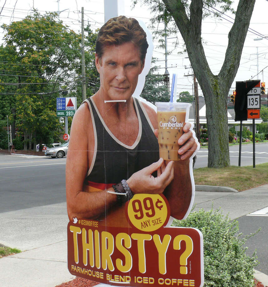 "This sign of ""Baywatch"" star David Hasselhoff could be seen at the Cumberland Farms at the Post Road. Like many others in town, it is illegal under local zoning regulations. It has since been taken down. Photo: Genevieve Reilly / Fairfield Citizen"