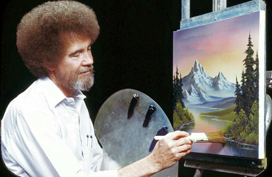 "This undated image released by Copyright Bob Ross Inc./The Joy of Painting, shows the late Bob Ross, host of the PBS series ""The Joy of Painting."""