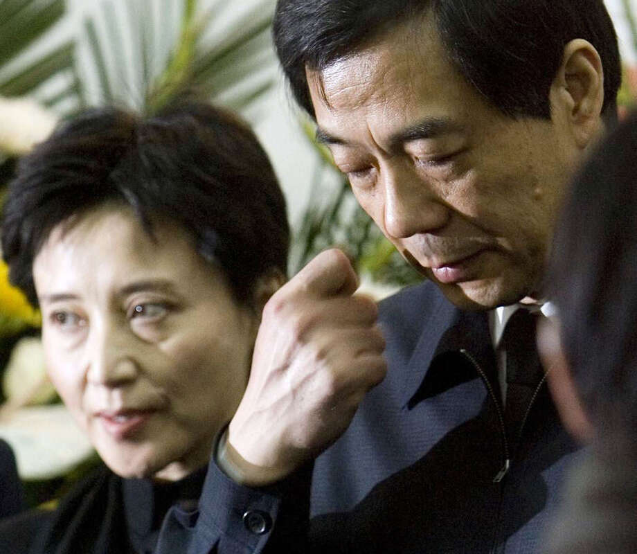 Gu Kailai, left, wife of former Chongqing Communist Party Secretary Bo Xilai, right, has been charged in the poisoning of a Briton last November. The man's body was found in a hotel in Chongqing. One of her aides also has been charged in the killing. / Kyodo News