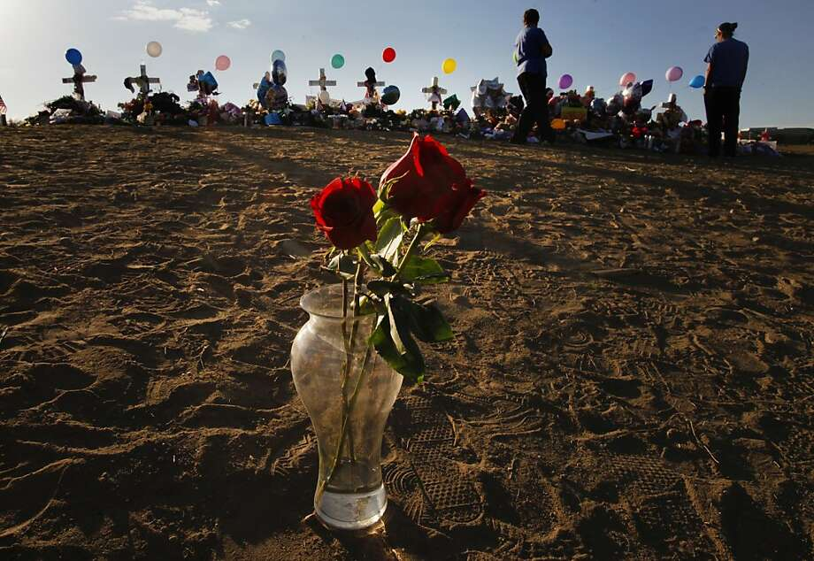 A new day begins as mourners leave crosses, messages and flowers at a roadside memorial across the street from the Century 16 theaters in Aurora, Colorado Thursday, July 26, 2012. Funerals and memorials have begun for the 12 killed in the mass shooting and several of the 58 wounded still remain hospitalized. (Mark Boster/Los Angeles Times/MCT) Photo: Mark Boster, McClatchy-Tribune News Service
