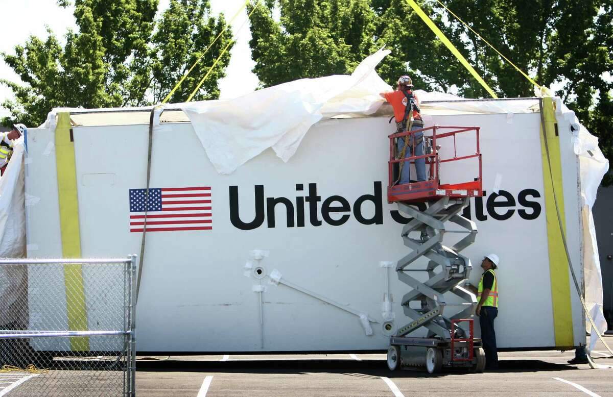 The aft section of the Space Shuttle Trainer payload bay is unwrapped after delivery to the Museum of Flight on Thursday, July 26, 2012. The crew cabin was delivered earlier to the museum aboard NASA's Super Guppy. The middle section of the Shuttle trainer is scheduled to be delivered on August 9th.